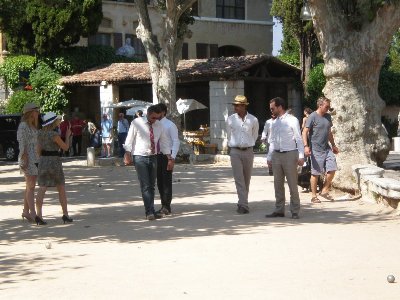 young stylish French playing boules
