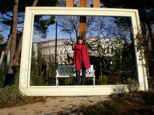 in Pula, Croatia a few years ago. I love my red coat:)