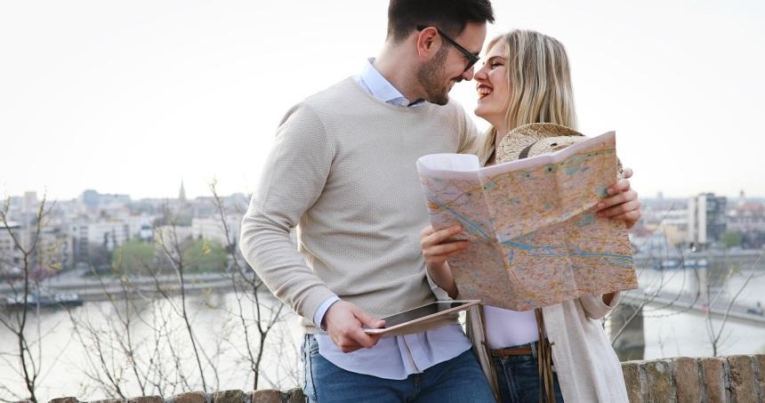 Tourist couple exploring city